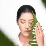 beautiful-woman-holding-green-plant_119653-62